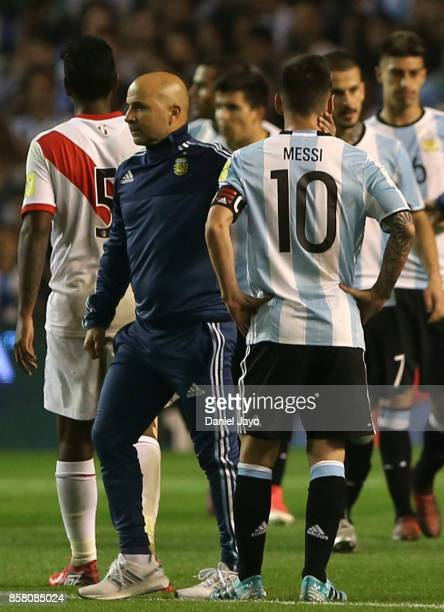 Lionel Messi of Argentina is conforted by Jorge Sampaoli coach of Argentina at the end of a match between Argentina and Peru as part of FIFA 2018...
