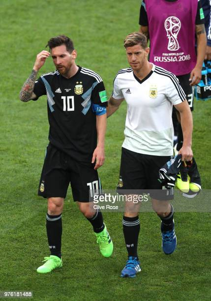 Lionel Messi of Argentina is consoled by team mate Cristian Ansaldi during the 2018 FIFA World Cup Russia group D match between Argentina and Iceland...