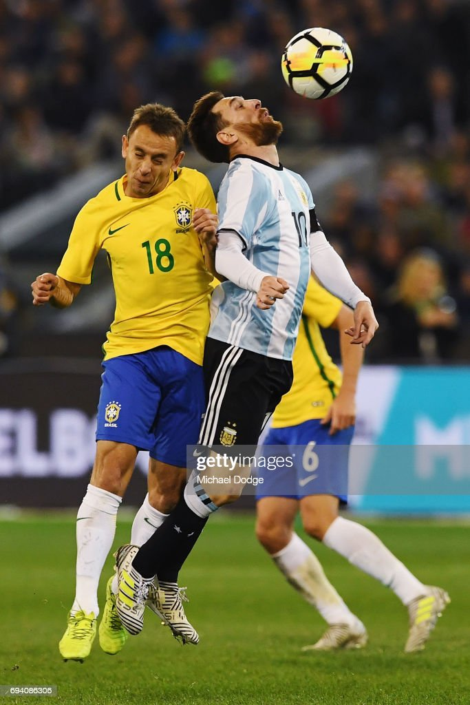 Lionel Messi of Argentina is crunched by Rafael Souza of Brazil during the Brasil Global Tour match between Brazil and Argentina at Melbourne Cricket Ground on June 9, 2017 in Melbourne, Australia.