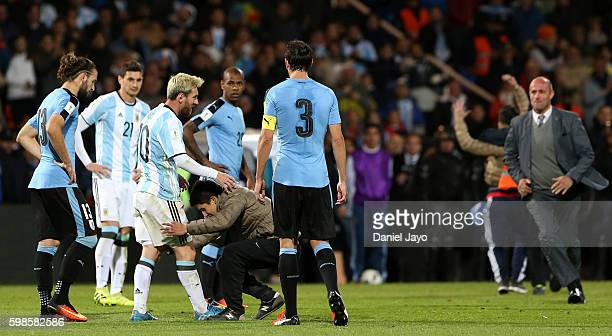 Lionel Messi of Argentina is embraced by a fan during a match between Argentina and Uruguay as part of FIFA 2018 World Cup Qualifiers at Malvinas...