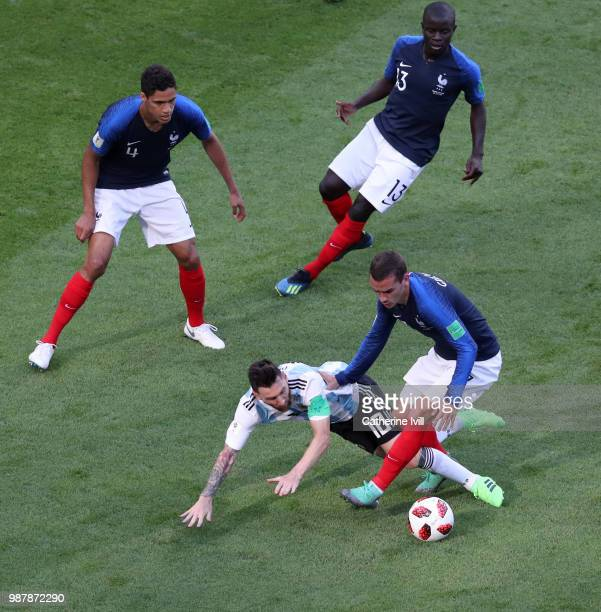 Lionel Messi of Argentina is fouled by Antoine Griezmann of France during the 2018 FIFA World Cup Russia Round of 16 match between France and...
