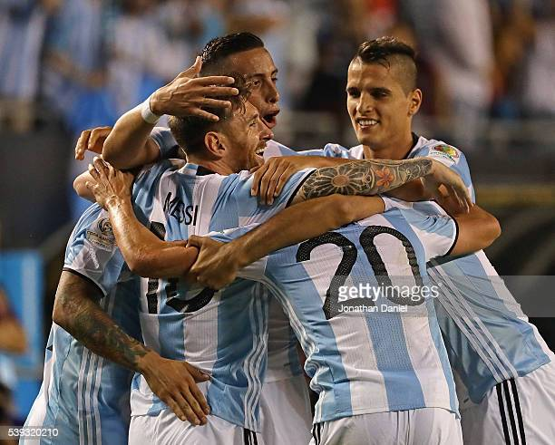 Lionel Messi of Argentina is hugged by teammates including Ever Banega Nicolas Gaitan and Gabriel Mercado after scoring a goal on a penalty kick...
