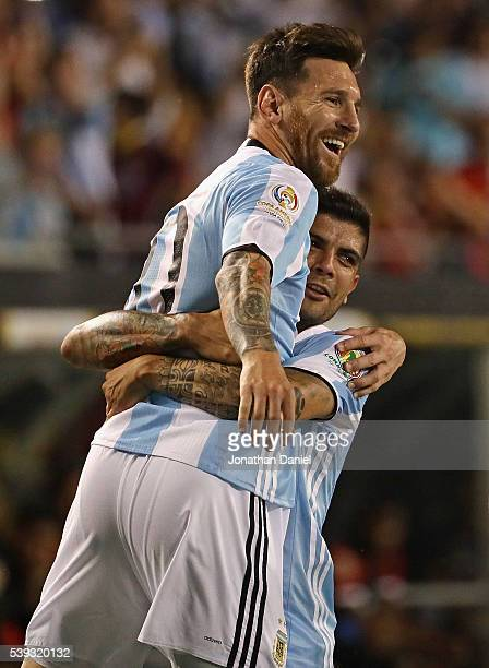 Lionel Messi of Argentina is lifted into the air by teammate Ever Banega after scoring a goal on a penalty kick against Panama during a match in the...