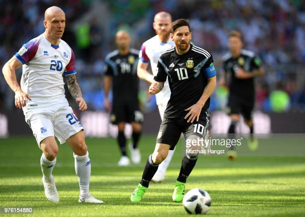 Lionel Messi of Argentina is marked by Emil Hallfredsson of Iceland as he watches on at the ball during the 2018 FIFA World Cup Russia group D match...