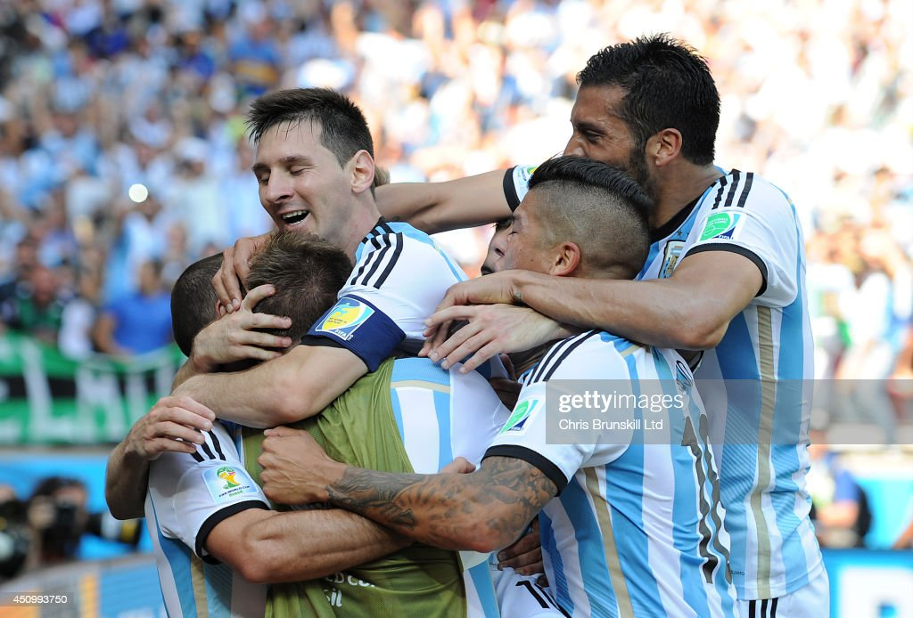 Lionel Messi of Argentina is mobbed by his team-mates after scoring the opening goal during the 2014 FIFA World Cup Brazil Group F match between Argentina and Iran at Estadio Mineirao on June 21, 2014 in Belo Horizonte, Brazil.