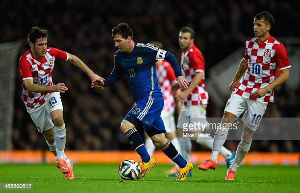 Lionel Messi of Argentina is surrounded by Croatian defenders during an International Friendly between Argentina and Croatia at Boleyn Ground on...