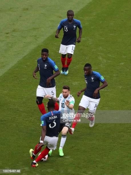Lionel Messi of Argentina is surrounded by Paul Pogba Samuel Umtiti N'golo Kante and Blaise Matuidi of France during the 2018 FIFA World Cup Russia...