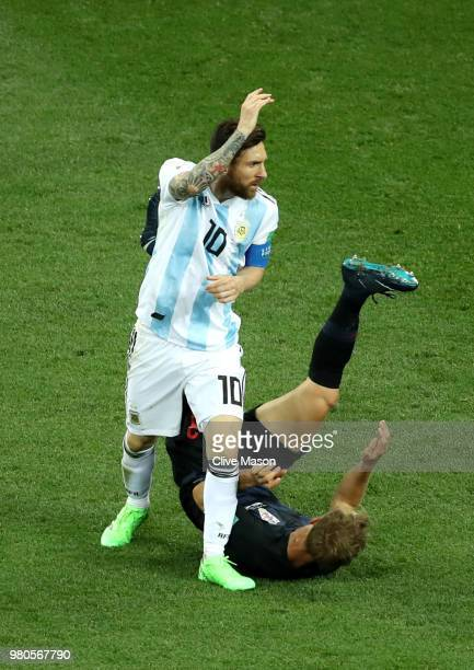 Lionel Messi of Argentina is tackled by Ivan Strinic of Croatia during the 2018 FIFA World Cup Russia group D match between Argentina and Croatia at...