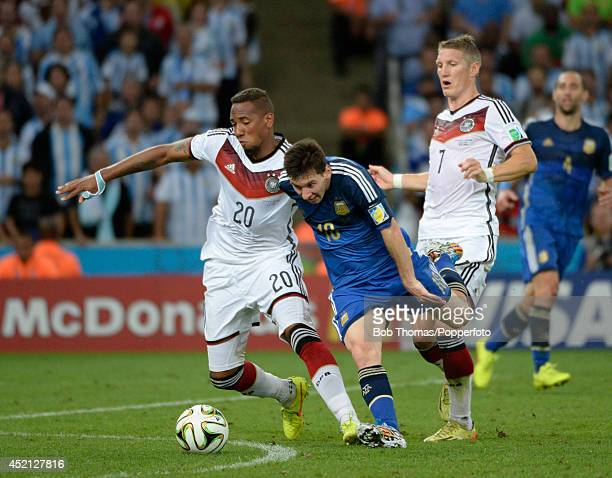 Lionel Messi of Argentina is tackled by Jerome Boateng of Germany during the 2014 FIFA World Cup Brazil Final match between Germany and Argentina at...