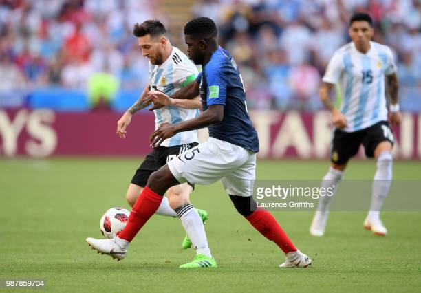 Lionel Messi of Argentina is tackled by Samuel Umtiti of France during the 2018 FIFA World Cup Russia Round of 16 match between France and Argentina...