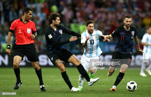 Lionel Messi of Argentina is tackled by Vedran Corluka and Marcelo Brozovic of Croatia during the 2018 FIFA World Cup Russia group D match between...