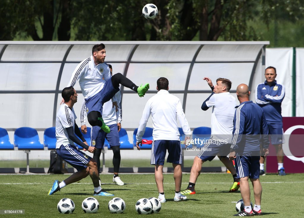 Lionel Messi of Argentina jump for the ball during the last training session before their first game of the FIFA World Cup 2018 at Bronnitsy Training Camp on June 15, 2018 in Bronnitsy, Russia.
