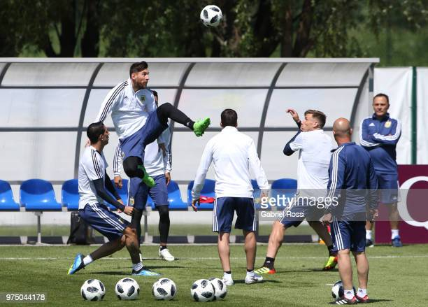 Lionel Messi of Argentina jump for the ball during the last training session before their first game of the FIFA World Cup 2018 at Bronnitsy Training...