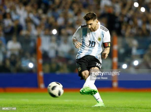 Lionel Messi of Argentina kicks a penalty to score the first goal of his team during an international friendly match between Argentina and Haiti at...
