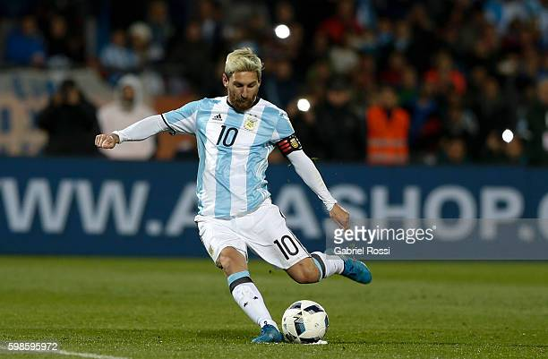 Lionel Messi of Argentina kicks the ball during a match between Argentina and Uruguay as part of FIFA 2018 World Cup Qualifiers at Malvinas...