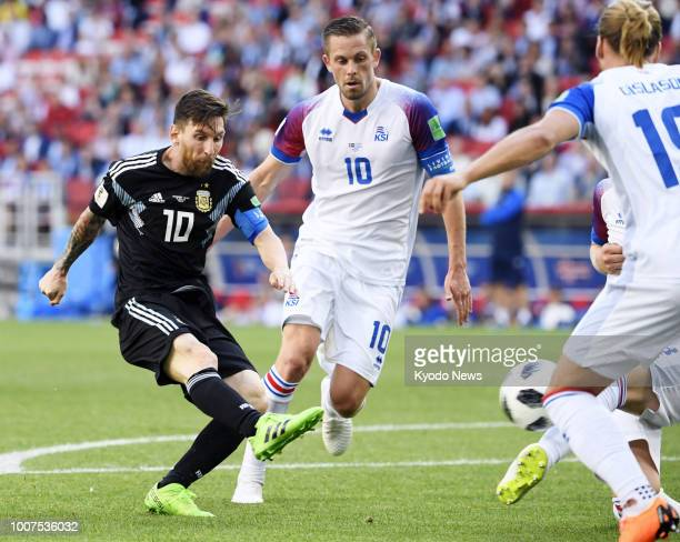Lionel Messi of Argentina kicks the ball past Gylfi Sigurdsson of Iceland at the end of a World Cup groupstage match at Spartak Stadium in Moscow on...