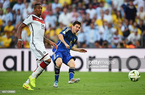 Lionel Messi of Argentina kicks the balll as Jerome Boateng of Germany gives chase during the 2014 FIFA World Cup Brazil Final match between Germany...