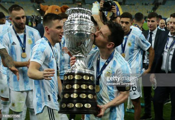 Lionel Messi of Argentina kisses the trophy as he celebrates with teammates after winning the final of Copa America Brazil 2021 between Brazil and...