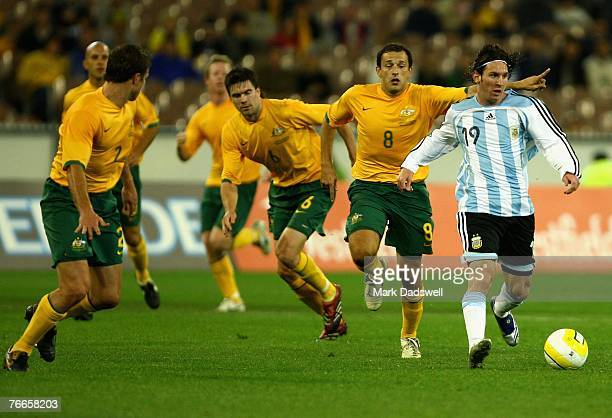 Lionel Messi of Argentina leads the Socceroos defence during the international friendly match between the Australian Socceroos and Argentina at the...
