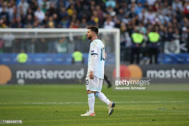 Lionel Messi of Argentina leaves the pitch after being sent off during the Copa America Brazil 2019 Third Place match between Argentina and Chile at...