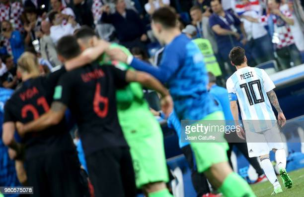 Lionel Messi of Argentina leaves the pitch while players of Croatia celebrate the victory following the 2018 FIFA World Cup Russia group D match...
