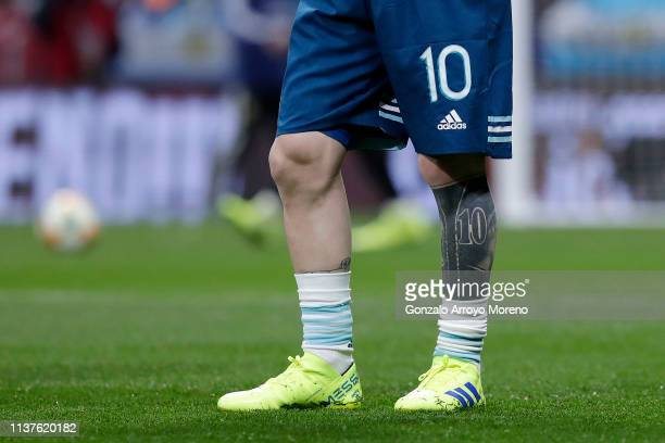 Lionel Messi of Argentina leg tattoo is seen as he warms up ahead of the International Friendly match between Argentina and Venezuela at Estadio...