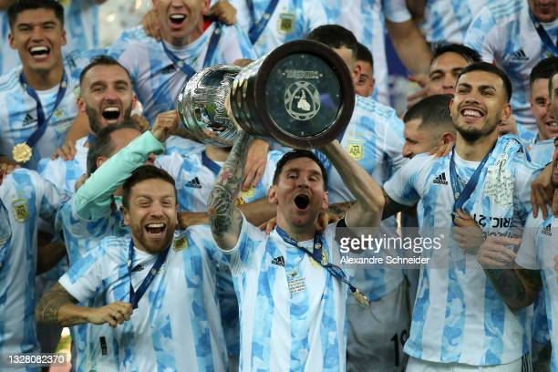 Lionel Messi of Argentina lifts the trophy with teammates after winning the final of Copa America Brazil 2021 between Brazil and Argentina at...