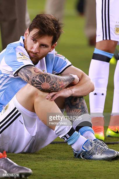 Lionel Messi of Argentina looks dejected after losing the championship match between Argentina and Chile at MetLife Stadium as part of Copa America...