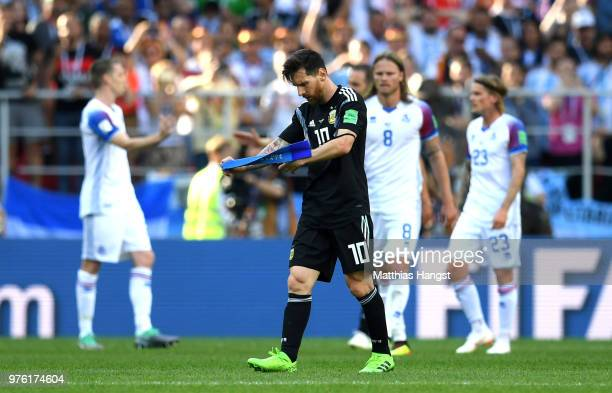Lionel Messi of Argentina looks dejected as walks off the pitch after the 2018 FIFA World Cup Russia group D match between Argentina and Iceland at...