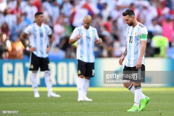 Lionel Messi of Argentina looks dejected following France's first goal during the 2018 FIFA World Cup Russia Round of 16 match between France and...