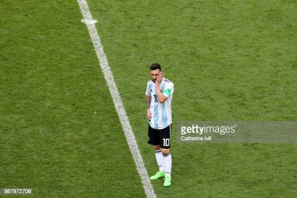 Lionel Messi of Argentina looks dejected following the 2018 FIFA World Cup Russia Round of 16 match between France and Argentina at Kazan Arena on...