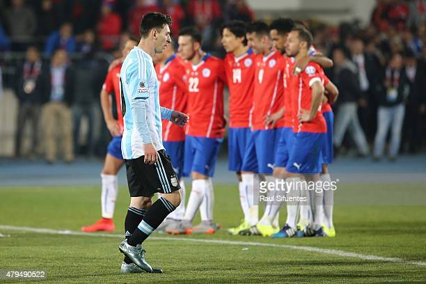 Lionel Messi of Argentina looks dejected in the penalty shootout during the 2015 Copa America Chile Final match between Chile and Argentina at...