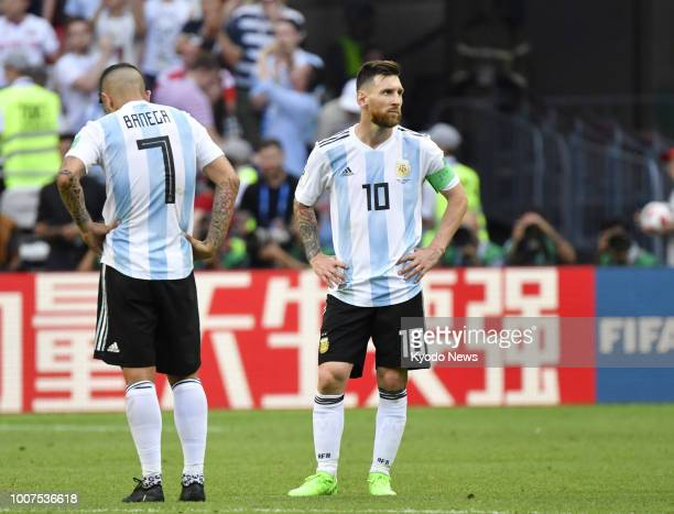 Lionel Messi of Argentina looks dejected near his teammate Ever Banega after losing 43 to France in a World Cup roundof16 match against France in...