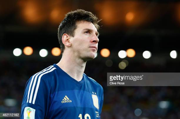 Lionel Messi of Argentina looks on after being defeated by Germany 10 during the 2014 FIFA World Cup Brazil Final match between Germany and Argentina...