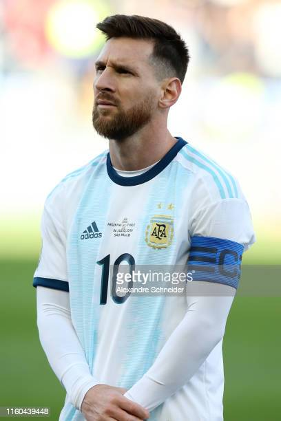 Lionel Messi of Argentina looks on during the national anthem prior to the Copa America Brazil 2019 Third Place match between Argentina and Chile at...