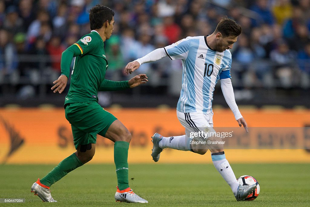 Lionel Messi of Argentina looks to pass the ball as Diego Bejarano of Bolivia defends during a group D match between Argentina and Bolivia at CenturyLink Field as part of Copa America Centenario US 2016 on June 14, 2016 in Seattle, Washington, US.