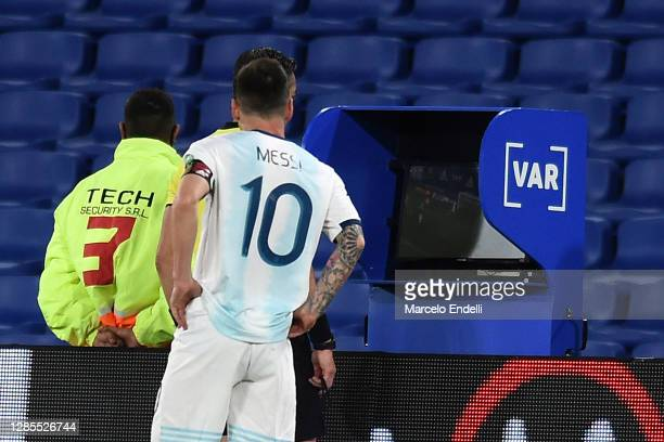 Lionel Messi of Argentina looks while referee Raphael Claus check the VAR to review a play during a match between Argentina and Paraguay as part of...
