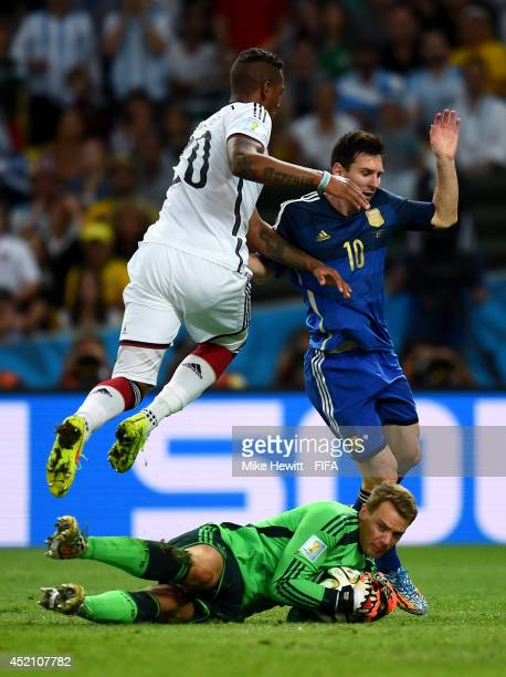 Lionel Messi of Argentina Manuel Neuer and Jerome Boateng of Germany compete for the ball during the 2014 FIFA World Cup Brazil Final match between...