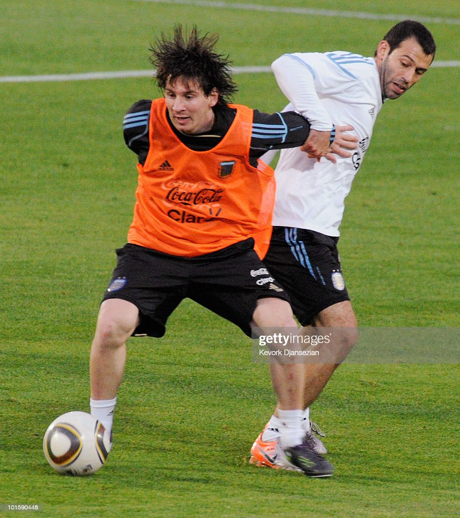Lionel Messi of Argentina national footbal team pushes his teammates Javier Mascherano during training session on June 3, 2010 in Pretoria, South Africa. Argentina opens their 2010 World Cup against Nigeria on June 12 in Johannesburg.