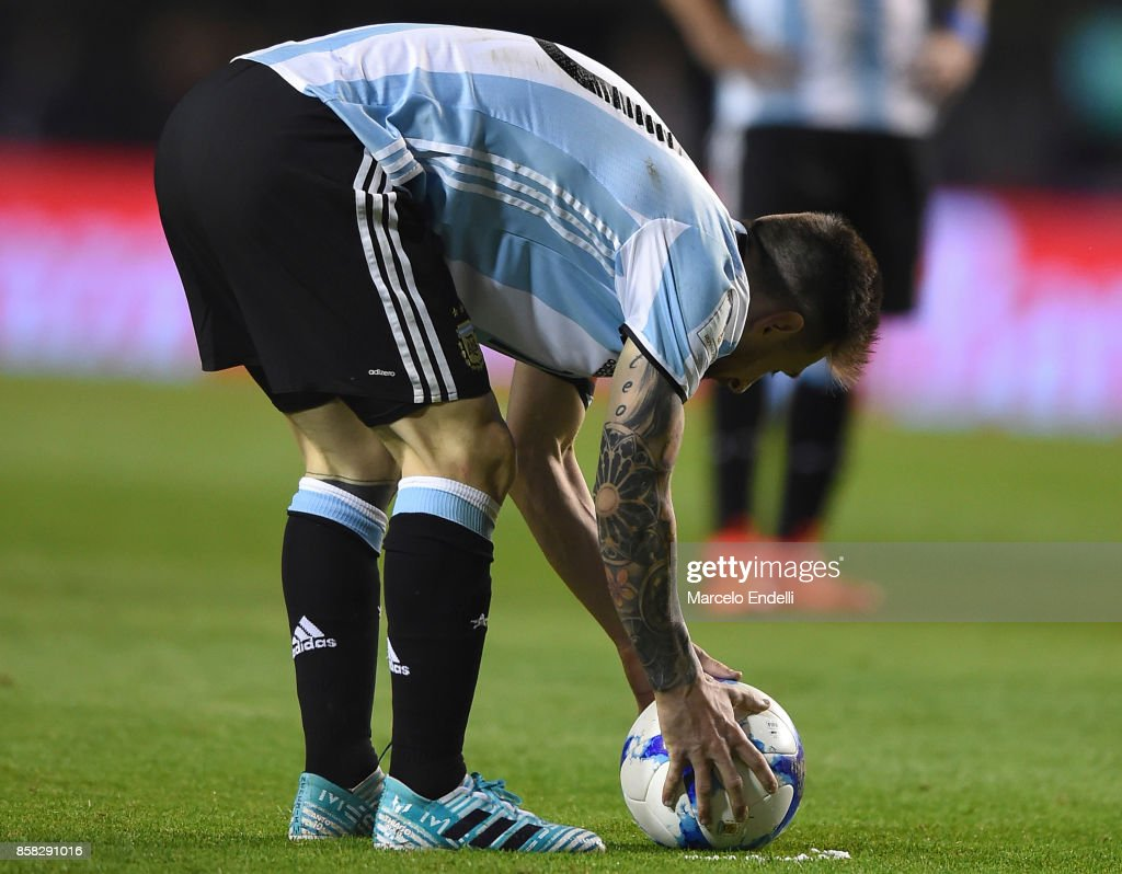 Lionel Messi of Argentina places the ball before a free kick during a match between Argentina and Peru as part of FIFA 2018 World Cup Qualifiers at Estadio Alberto J. Armando on October 5, 2017 in Buenos Aires, Argentina.