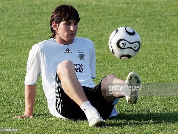 Lionel Messi of Argentina plays with a ball during a training session at the AdiDassler Sports Field on June 27 2006 in Herzogenaurach Germany...