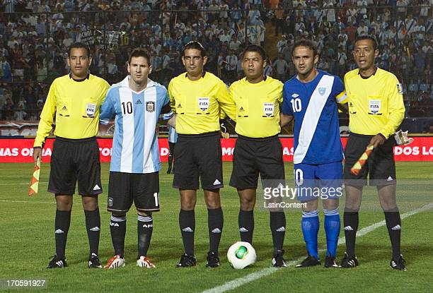 Lionel Messi of Argentina pose for a photo with referees and Guatemala's captain prior a friendly soccer match between Argentina and Guatemala at...