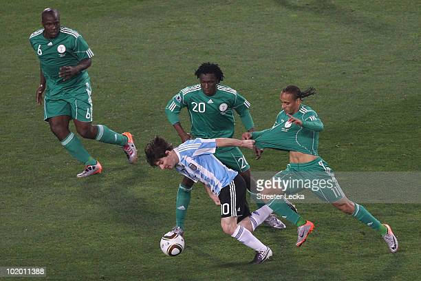 Lionel Messi of Argentina pulls the shirt of Peter Odemwingie of Nigeria during the 2010 FIFA World Cup South Africa Group B match between Argentina...