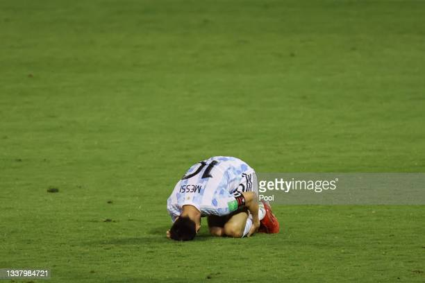Lionel Messi of Argentina reacts after being fouled during a match between Venezuela and Argentina as part of South American Qualifiers for Qatar...