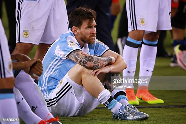 Lionel Messi of Argentina reacts after losing the championship match between Argentina and Chile at MetLife Stadium as part of Copa America...