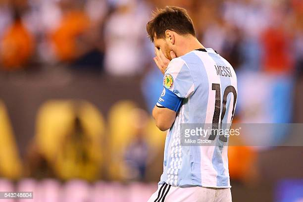 Lionel Messi of Argentina reacts after missing a penalty kick against Chile during the Copa America Centenario Championship match at MetLife Stadium...