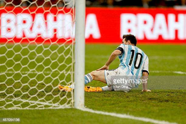 Lionel Messi of Argentina reacts after missing a penalty kick during a match between Argentina and Brazil as part of 2014 Superclasico de las...