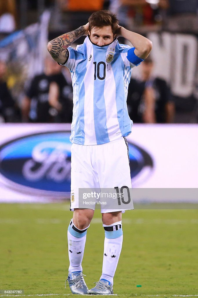 Lionel Messi of Argentina reacts after missing his penalty during the championship match between Argentina and Chile at MetLife Stadium as part of Copa America Centenario US 2016 on June 26, 2016 in East Rutherford, New Jersey, US.