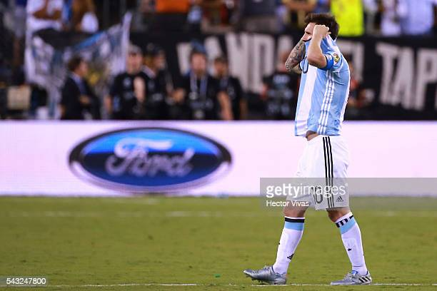 Lionel Messi of Argentina reacts after missing his penalty during the championship match between Argentina and Chile at MetLife Stadium as part of...