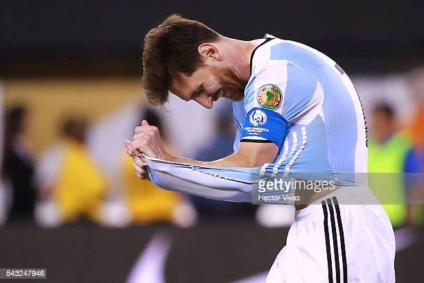 Lionel Messi of Argentina reacts after missing his penaly kick during the championship match between Argentina and Chile at MetLife Stadium as part...